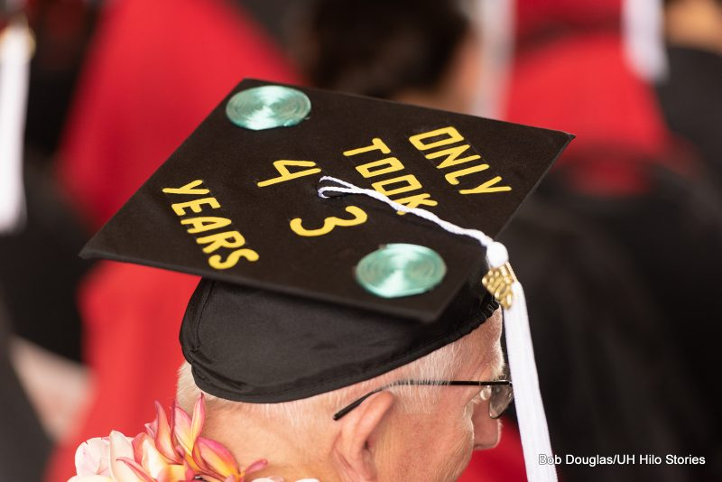 Mortarboard with the words: ONLY TOOK 43 YEARS