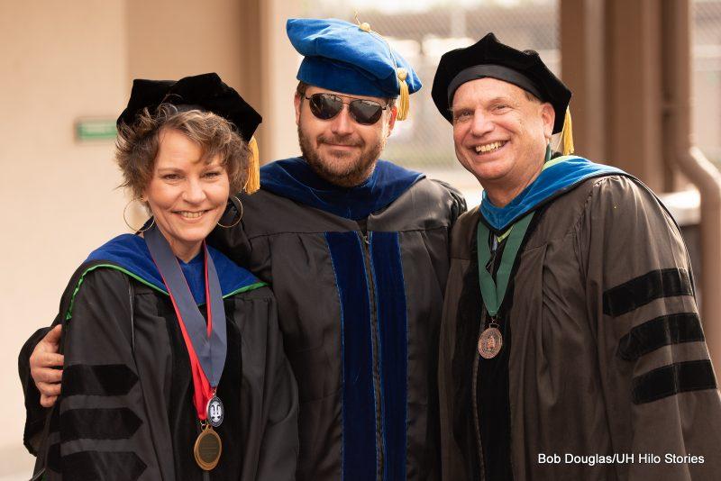Three professors in regalia.