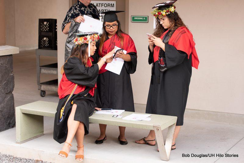 Graduates talking.