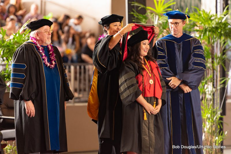 Doctoral student receives her hood.