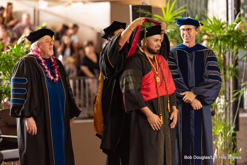 Pharmacy doctoral student receives hood.
