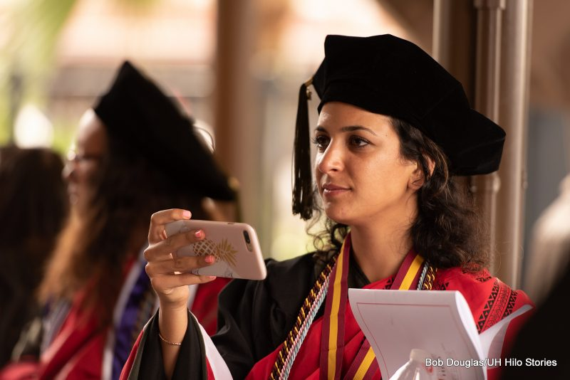 Graduate with cell phone.