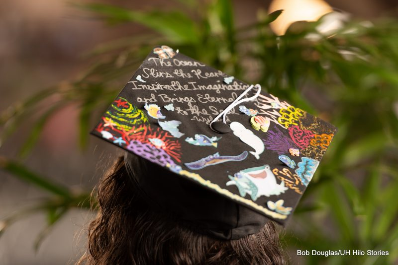 Mortarboard with the words: The Ocean Stirs the Heart.