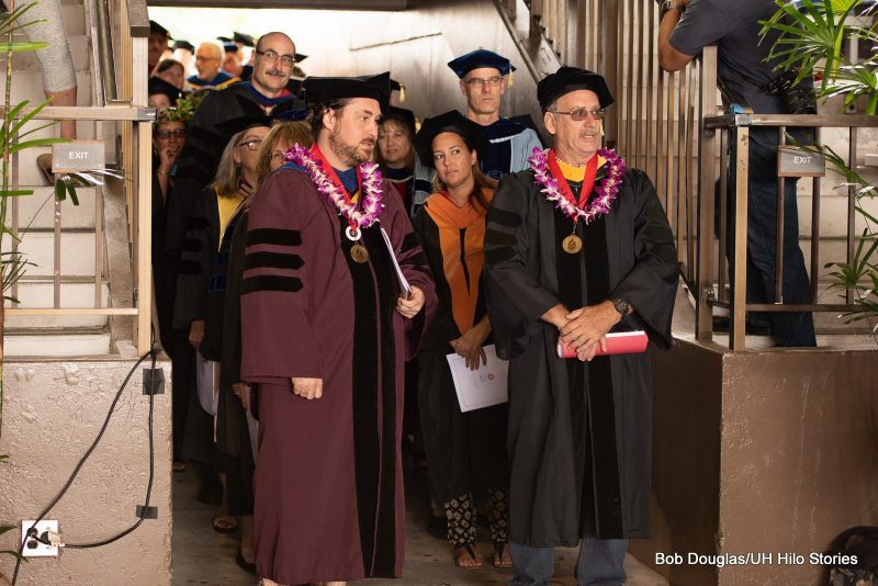 Faculty enter venue.