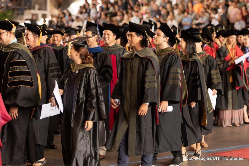 Pharmacy graduates enter together.