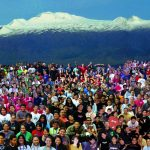 Students photoshopped together with Maunakea in background.