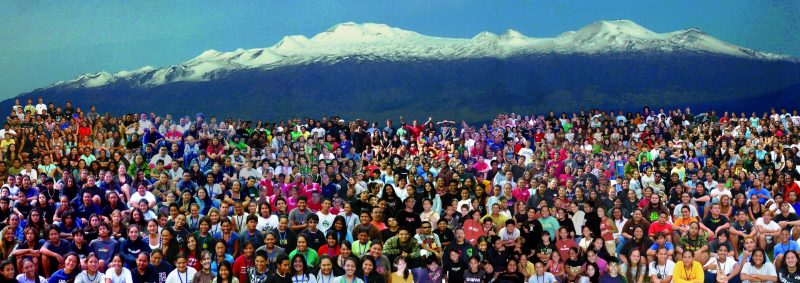 Large groups of students photoshopped together with Maunakea in background.