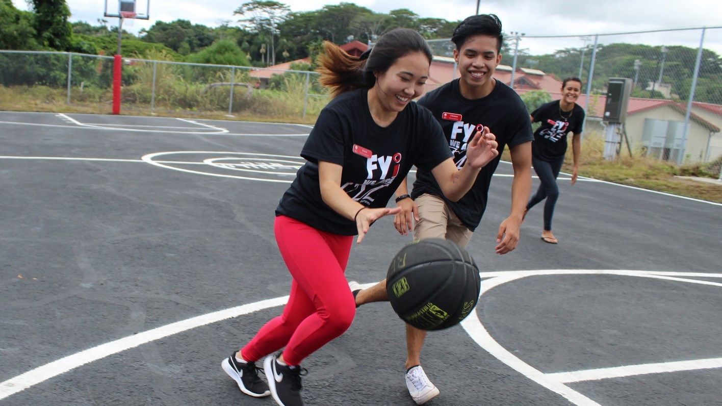 New gathering place for UH Hilo students: Outdoor basketball court with adjacent grill and picnic tables, solar e-charging stations