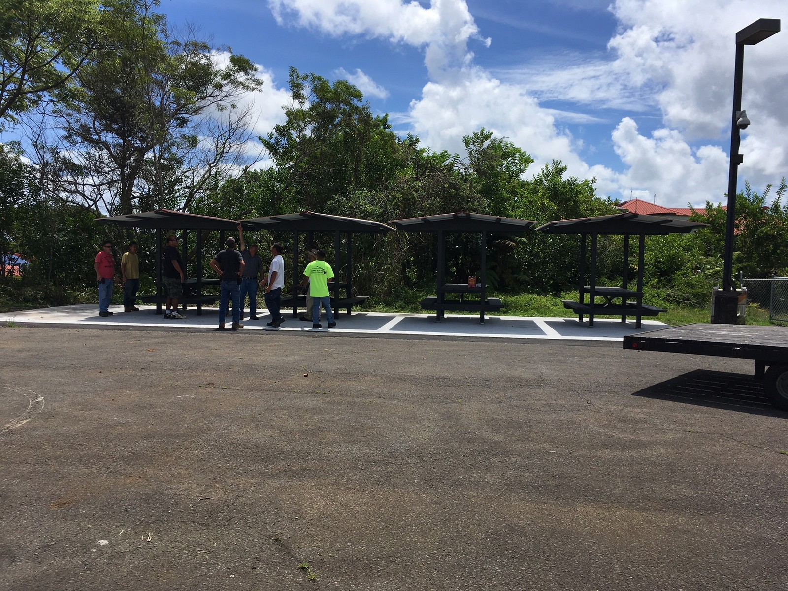 Crew discussing table area (roof).