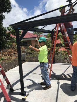 Worker inspecting frame.