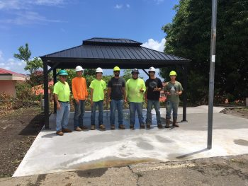 Team of construction workers in front of the gazebo.