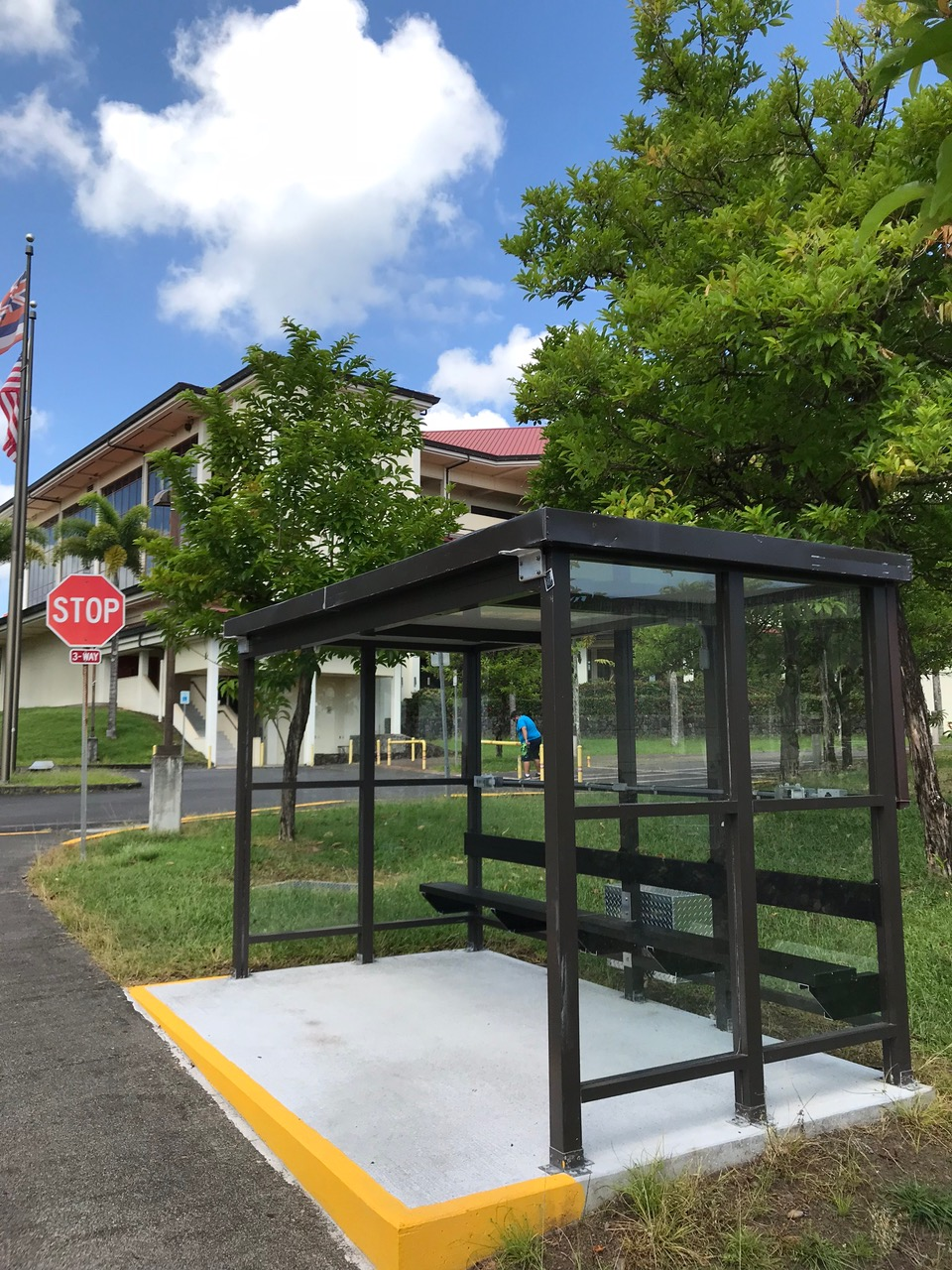 Glass enclosed shelter with benches.