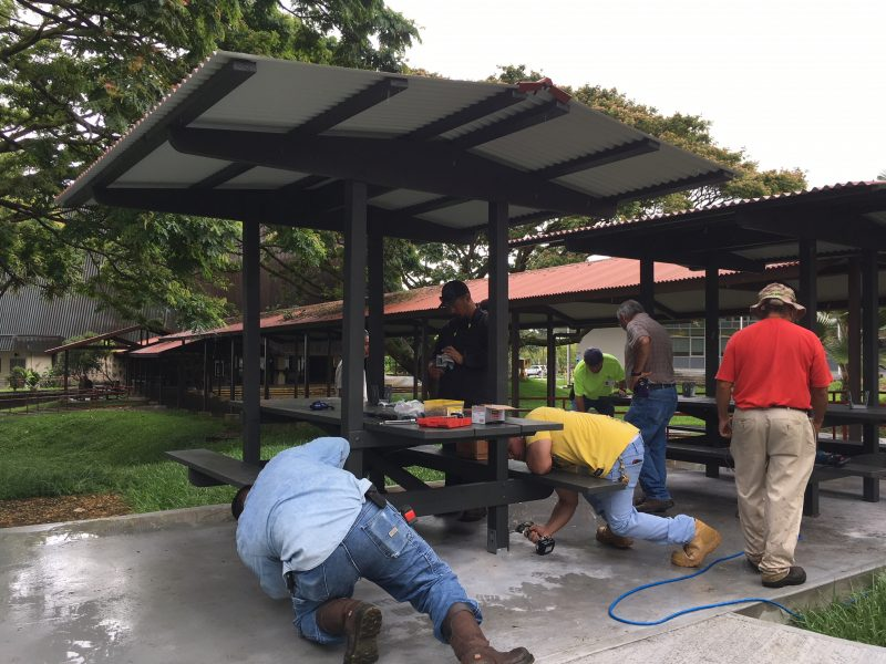 Workers building the shelter.