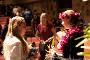 Speaking with member of the audience.