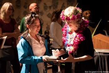 Doudna signs book for member of the audience.