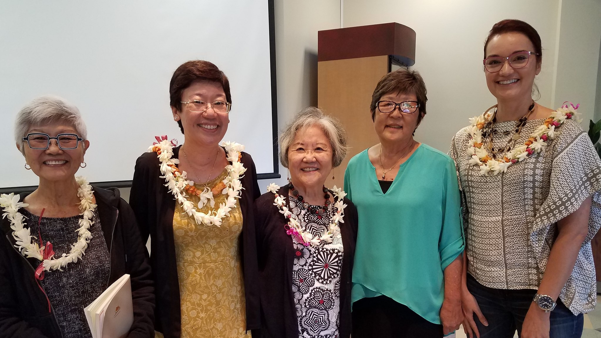 (Left to right) Juliet S. Kono, Jean Yamasaki Toyama, Ann Inoshita, Marcia Sakai, and Christy Passion stand together for photo.
