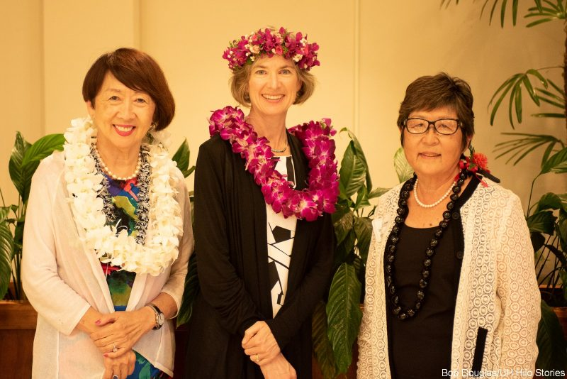 Posing for photo, each has a lei: Rose Tseng, Jennifer Doudna, and Marcia Sakai.