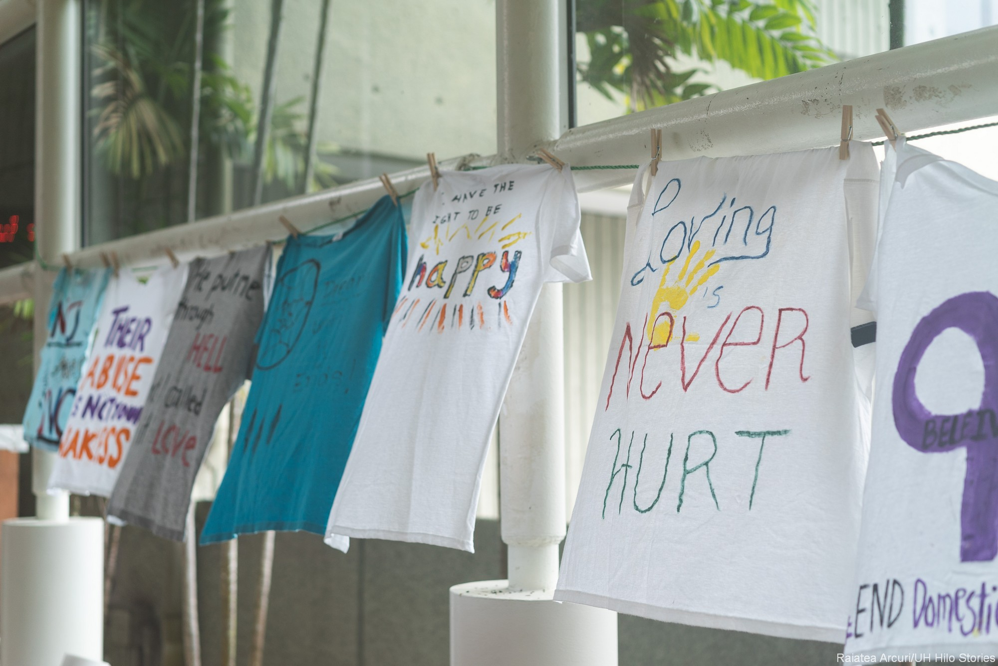 T-shirt with the words: LOVING NEVER HURT.