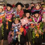 Group of graduates bedecked in lei.