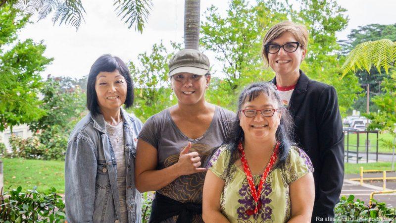 Diversity Committee Susan Shirachi, Dana Ko'omoa-Lange, Kristi Doran,and Jennifer Stotter stand for a group photo. Dana is giving the shaka.