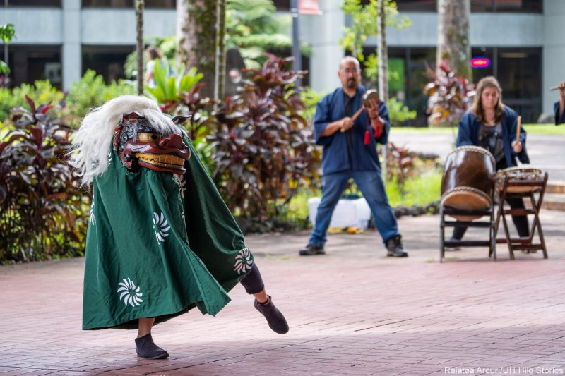 Chinese dragon dancing on plaza.
