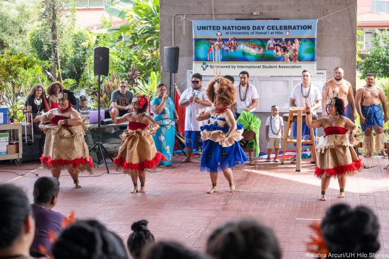 Samoan Club performs group dance. Women are in traditional dress of grass skirts and elaborate headdresses