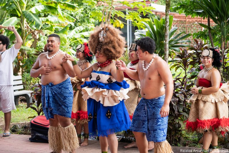 Two males and female in traditional attire of Samoa.