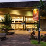 Mokini Library at night, fully lit.