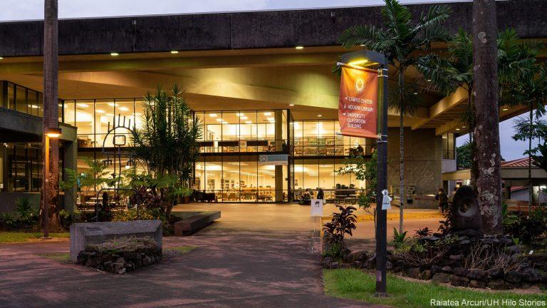 Mokini Library at night, fully lit.