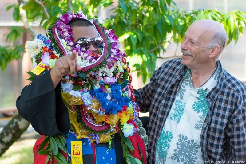 Graduate in lei al the way up over his eyes.