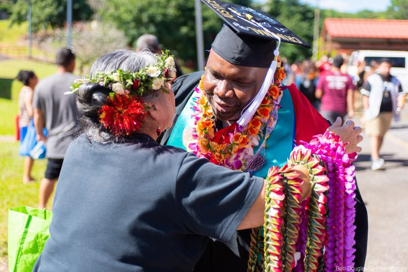 Graduate receives a lei.