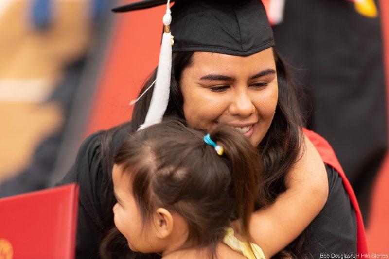 Candidate hugs young girl.