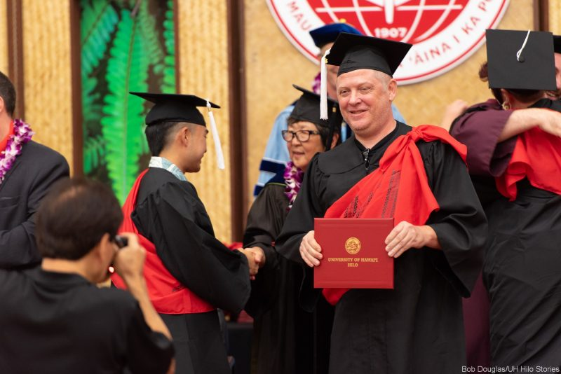 Candidate receives diploma on the dais.