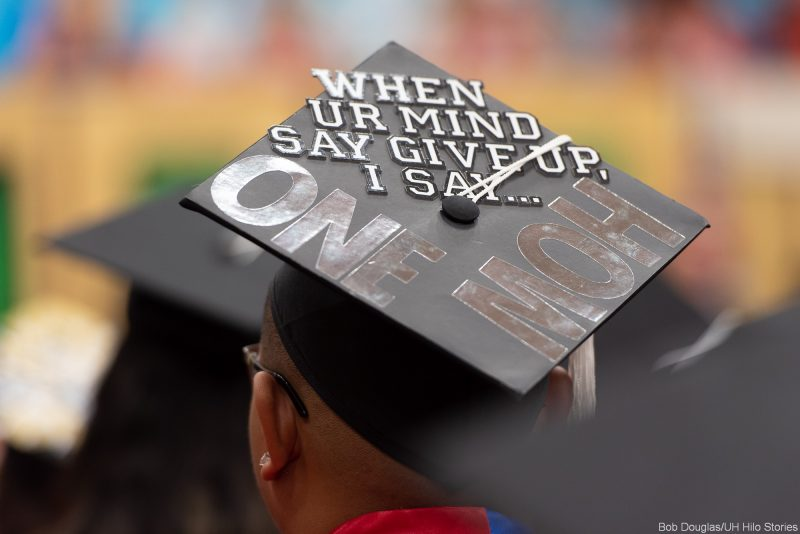Message on mortarboard: WHEN UR MIND SAY GIVE UP, I SAY... ONE MOH
