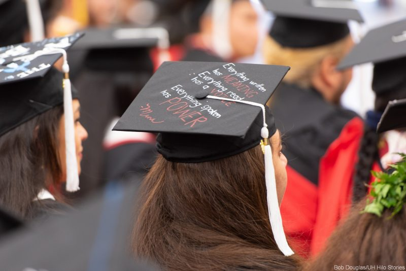 On mortarboard: Everything written has meaning. Everything read has a voice. Everything spoken has power. -Mana