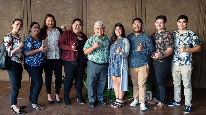 Group of students and advisor stand with Rep. Onishi.