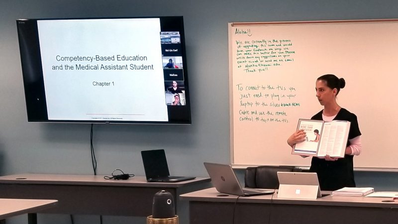 Kara Osada-D'Avella at large screen with the words: Competency-Based Education and the Medical Assistant Student, Chapter 1.