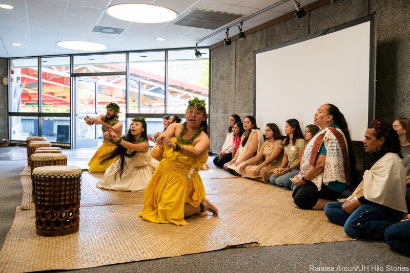 Dancers on lauhala mats.