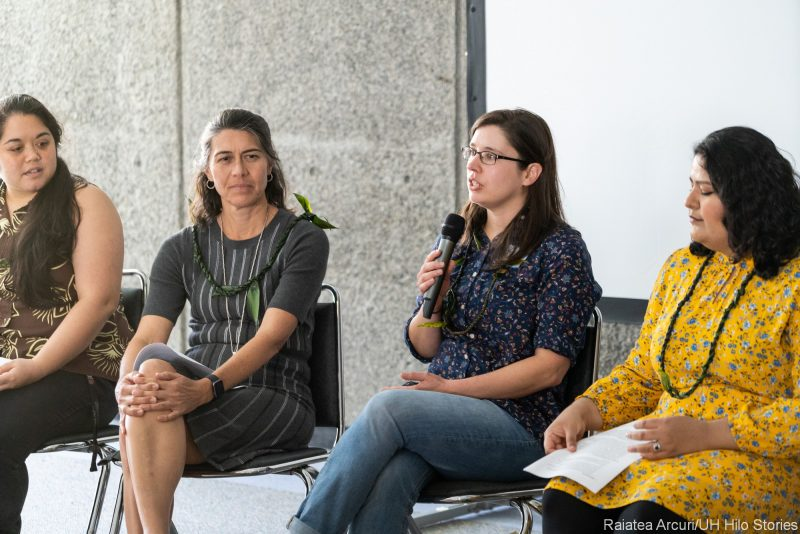 Seated panel of four with moderator.