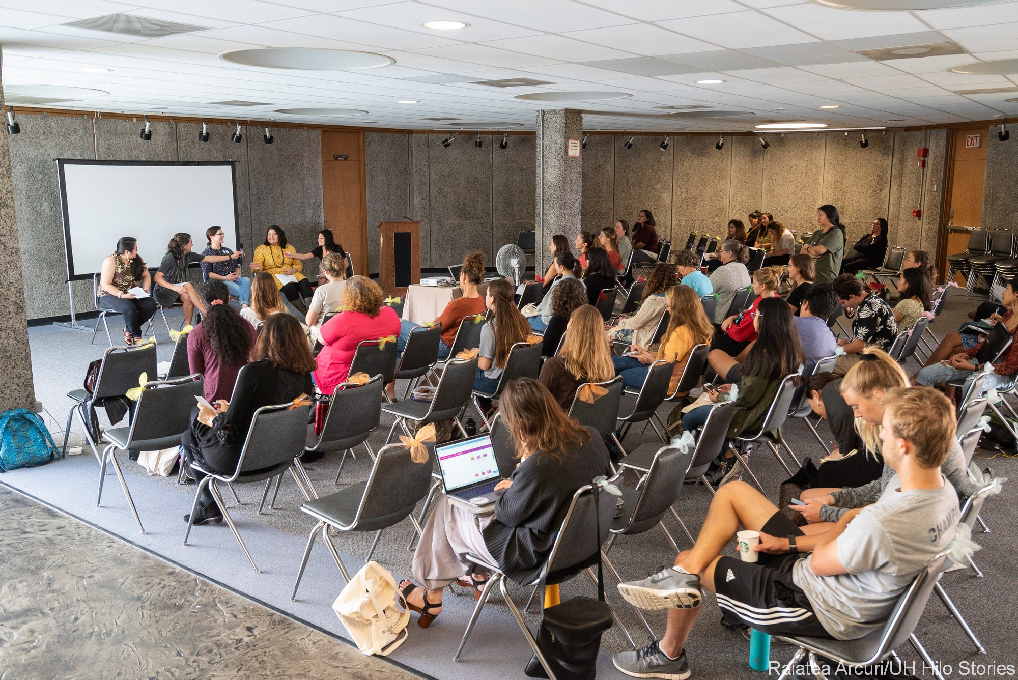 Wide view of audience and panel.