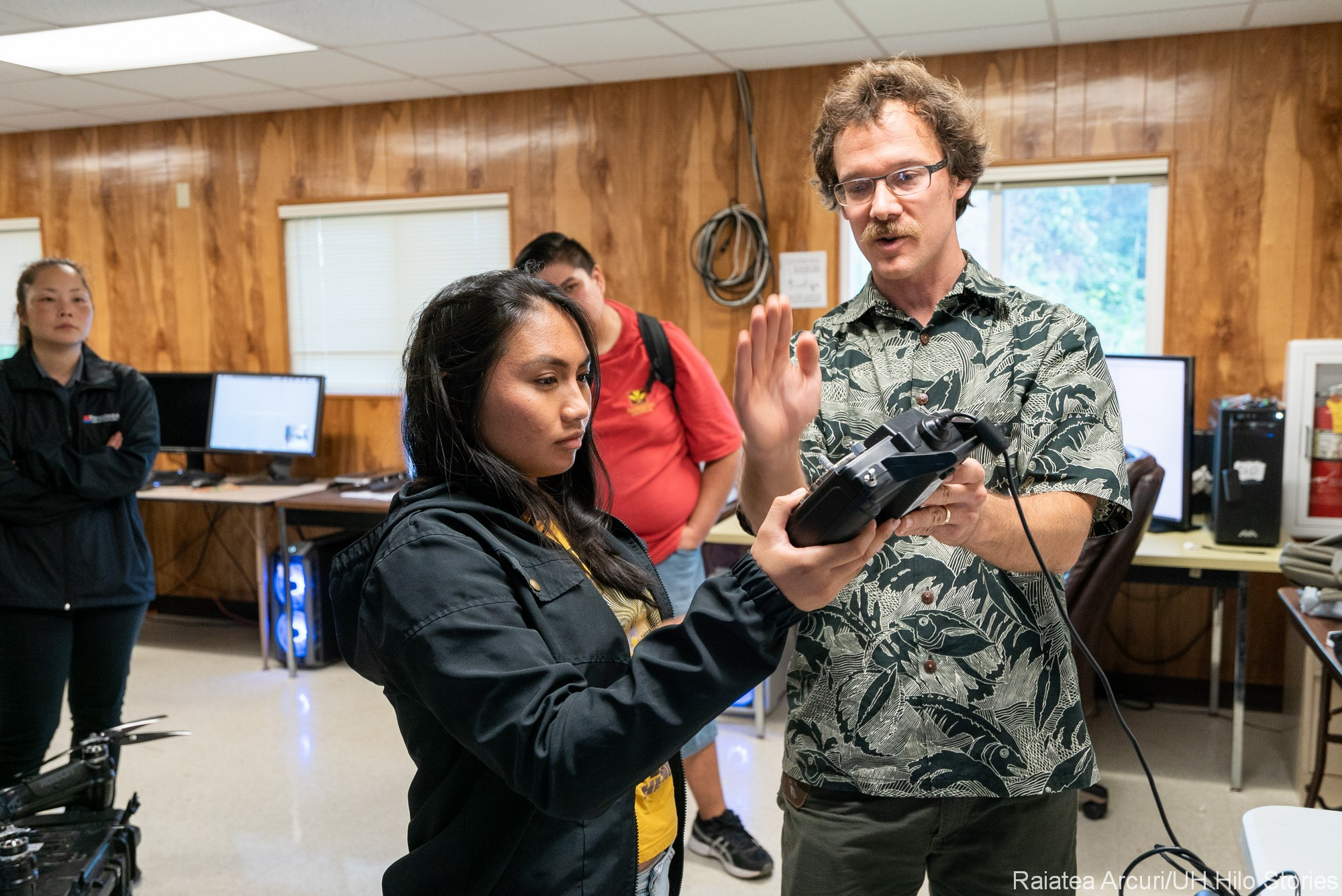 Student and professor, student holds controller.