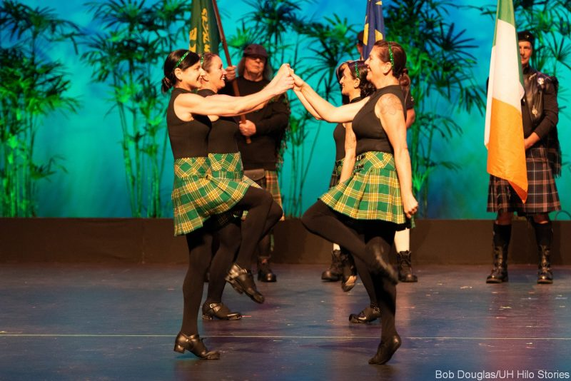Group of female Irish dancers in traditional dress.