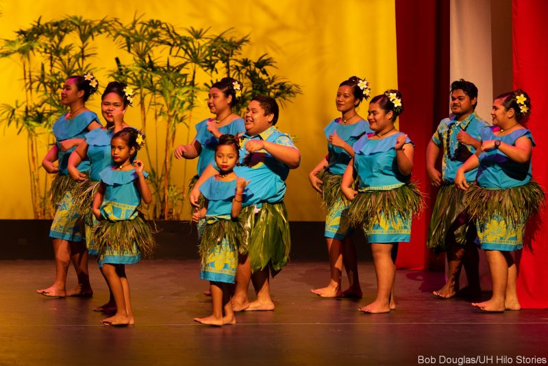 Palau dancers in blue, ti skirt at waist.