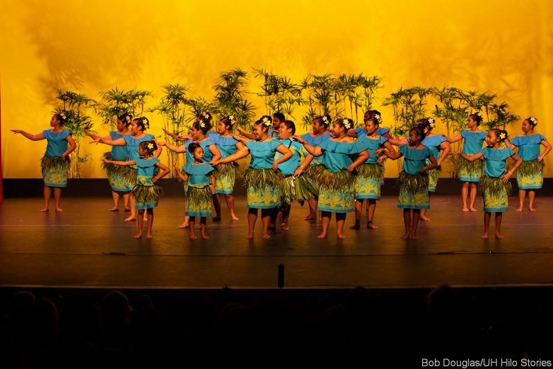 Group of Palau dancers in blue, ti skirt at waist.