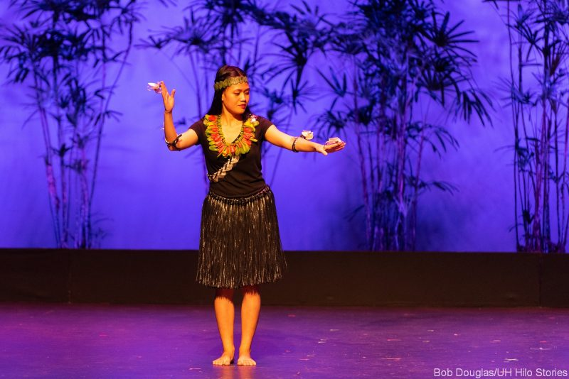 Solo woman dancing, grass dress.