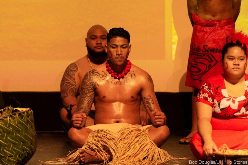 Samoan dancers sitting.