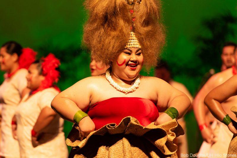 Featuring Samoan women in head dresses dancing.