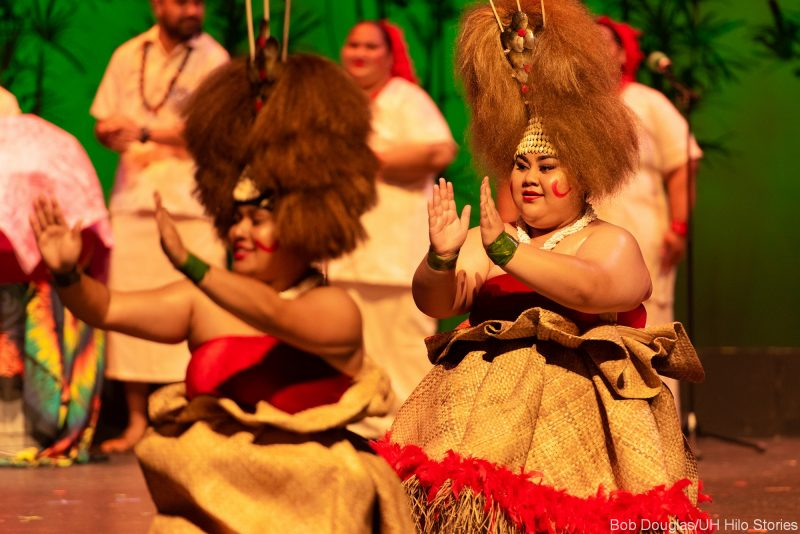Featuring female dancers in head dresses.