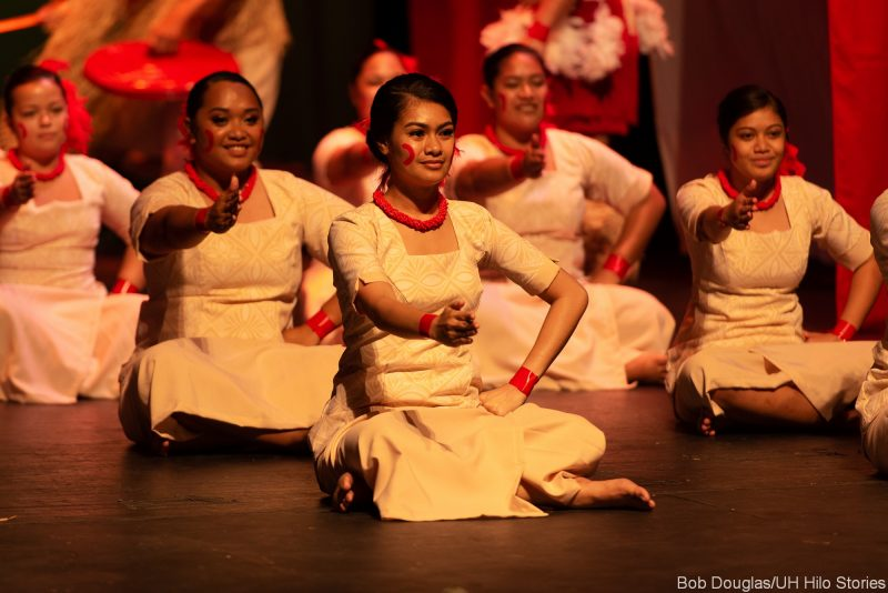 Large group of Samoan dancers seated for dance