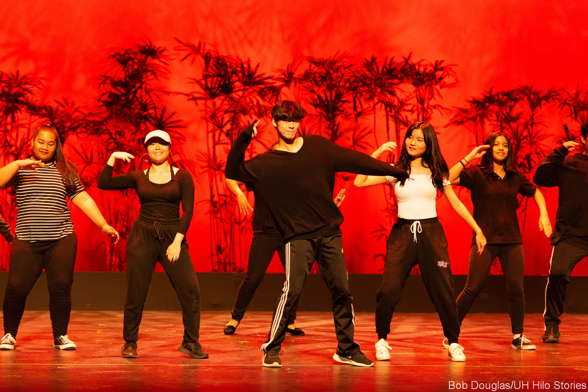 Modern dancers in street clothes.